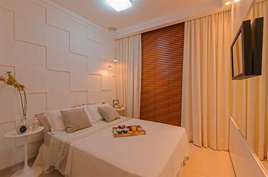 Parede de fundo do quarto de casal decorada com revestimento 3D