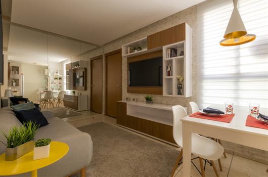 Sala de apartamento MRV decorada com móveis modulados