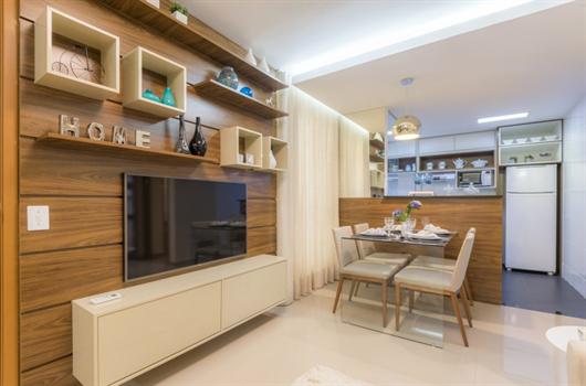 Sala de jantar em decorado MRV com piso porcelanato na cor bege