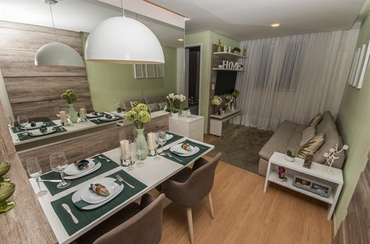 Sala de estar e jantar de um apartamento MRV com diferentes tons de verde na decoração